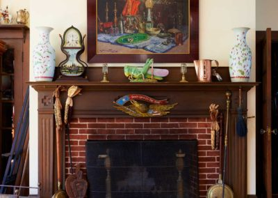 A fireplace in the entryway to the Tea Room.